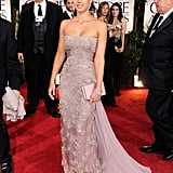 Jessica Alba was at the Golden Globe Awards in a Gucci dress.