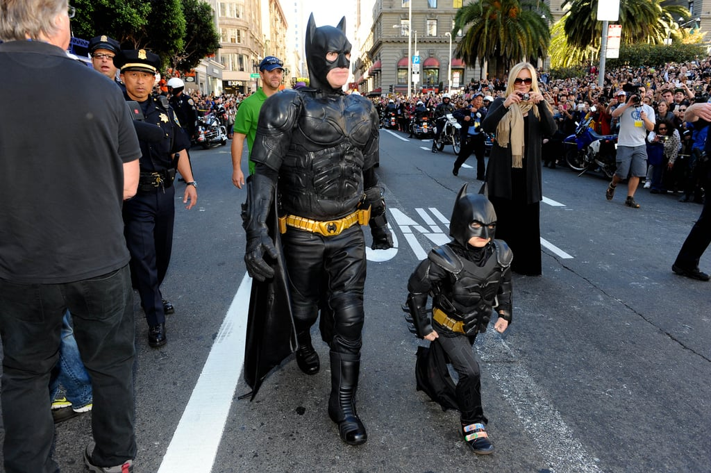 "Miles Scott, the boy who played ""Bat Kid"" for the day in San Francisco five years ago with help from the Make-A-Wish Foundation, is officially cancer-free.  The Make-A-Wish Foundation gave an update on Miles on the fifth anniversary of his big day, and we're happy to hear it's all good news. ""Now 10 years old and in fifth grade, Miles loves science and robotics,"" the nonprofit wrote on its website. ""After fighting his own heroic battle with leukemia since he was a year old, Miles visits his oncologist once a year, and has been in remission from leukemia for the past five years.""  If you don't remember, on Nov. 15, 2013, the city of San Francisco completely transformed into a real-life Gotham City thanks to the help of thousands of volunteers. Throughout the day, Miles got the chance to rescue a damsel in distress and take on evil villains like The Riddler with the help of local police officers.  Not only did the event mean the world to Miles and his family, but it also helped other children with pediatric cancer.  ""We saw an increase in offers of help across all areas, including donations, volunteers, referrals, and other services,"" said a Make-A-Wish spokesperson. ""In fact, the volume of traffic on our servers caused our system-wide websites to go down for several hours on the day of his wish.""  Scroll through to get a bird's eye view of his perfect day in Gotham City five years ago.       Related:                                                                                                           This Is 10 Months With Pediatric Cancer"
