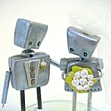 The loving gestures of these robots say it all. Jtnee's Robot Wedding Topper ($100) is worth every penny for such precious detailing.