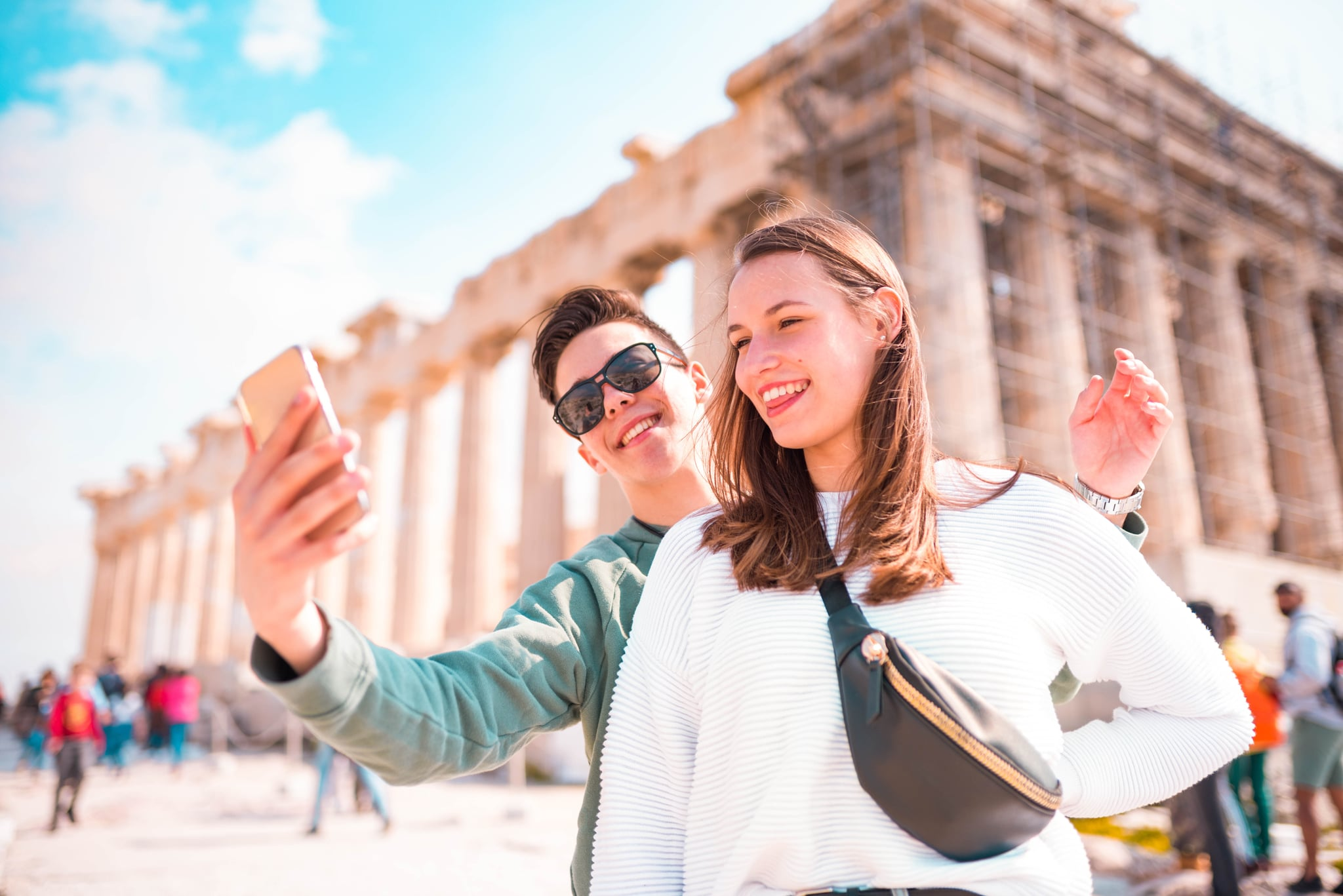 Tourist couple taking a selfie  in Acropolis - Athens.