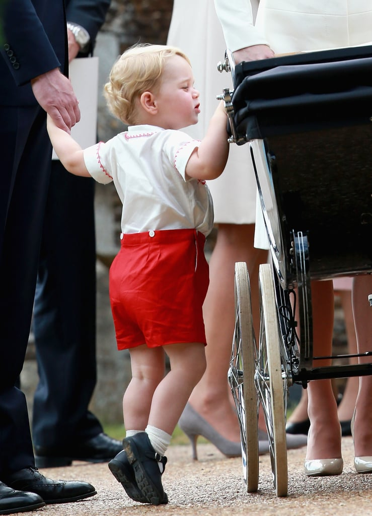 Although Sunday's christening marked a special occasion for Princess Charlotte, her big brother stole the spotlight with his adorable facial expressions. Prince George couldn't have been cuter as he walked hand in hand with his parents, Prince William and Kate Middleton, as they made their way to the church with Princess Charlotte in her pram. Sporting a sweet outfit very similar to one Prince William wore when he was little, Prince George waved to the crowd, peeked into the pram to glance at his sister, and chatted with his grandmother Queen Elizabeth II as they stood outside the Church of St. Mary Magdalene on Queen Elizabeth II's Sandringham Estate.  Keep reading to see the cutest pictures of Prince George during the royal outing, then check out all the pictures from Princess Charlotte's christening and find out which five people were honored as Princess Charlotte's godparents.