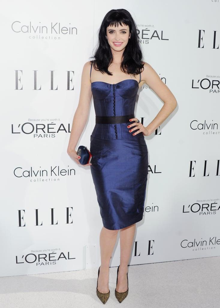 Krysten Ritter took the sexy approach in a corseted metallic blue sheath.