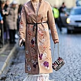 Tired of the same old camel coat? Find pieces that also have cool added designs or embroideries.