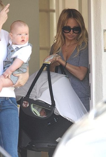 Nicole and baby Harlow leaving a party.