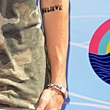 Justin Bieber showed off his tattoo at the Teen Choice Awards.