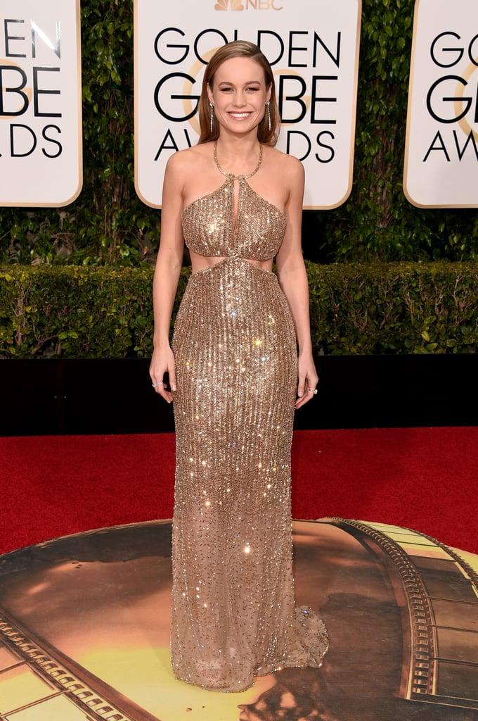 Brie Larson in a Calvin Klein dress, Salvatore Ferragamo heels, and jewlery by Tiffany & Co. in 2016.