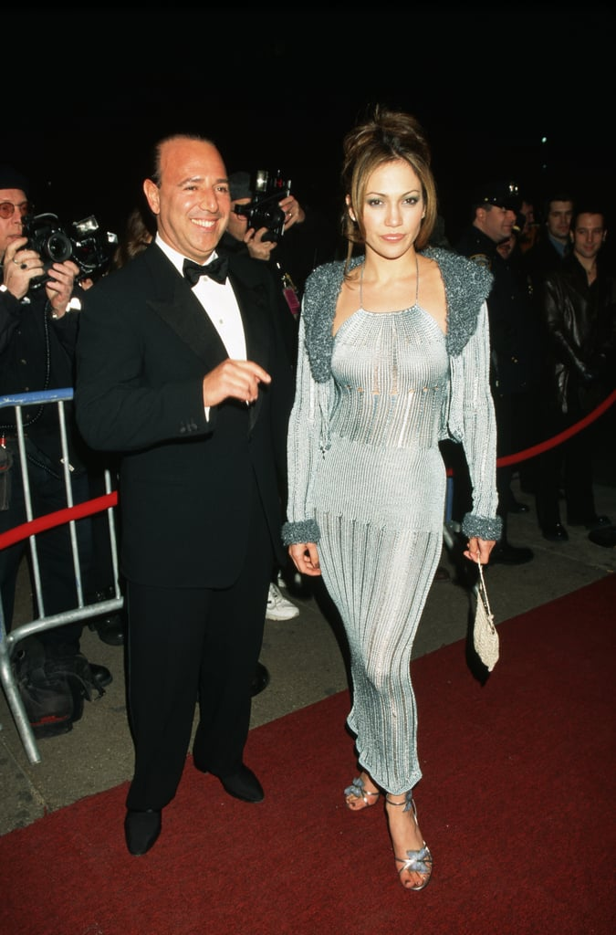 "Your first memory of Jennifer Lopez at the Grammy Awards might be one of the singer and actress in 2000 right next to then-boyfriend Sean ""Diddy"" Combs looking fly and . . . oh, yeah, wearing that insane, low-cut, green Versace dress that shook the world so hard, even Google had to come out with Image Search because people couldn't get enough of J Lo. But that wasn't the first time Jennifer appeared on the Grammys red carpet. J Lo's first appearance (before she was J Lo) was in 1998, when she walked into Radio City Music Hall in New York City with none other than Tommy Mottola — yes, Thalia's now-husband. The dress she was wearing was not Versace. In fact, we can't figure out if her sparkly silver number topped with a matching coat with shaggy trimmings on the neckline and sleeves was even a designer look at all.       Related:                                                                                                           Every Single Naked Dress Jennifer Lopez Has Worn Since 1997"