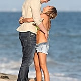 Birthday girl Ashley Tisdale showed PDA with Scott Speer on the beach in Malibu in July.
