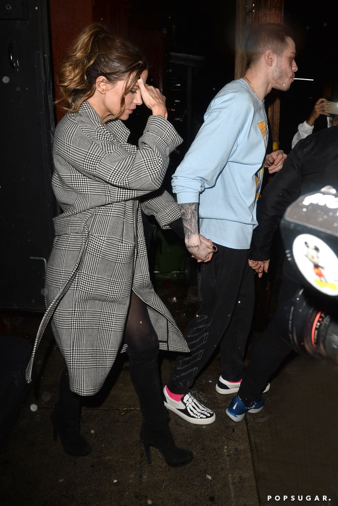 Pete Davidson and Kate Beckinsale just added some more fuel to those fiery romance rumors. Shortly after Pete celebrated Kid Cudi's birthday with a few other unexpected guests, the 25-year-old Saturday Night Live star put on a comedy set in Los Angeles on Friday, with Kate supporting him from the crowd. They left the show hand in hand and reportedly returned to Pete's Santa Monica hotel together.  Pete and the 45-year-old actress hit it off back in January, when they were seen flirting and getting cozy at Netflix's Golden Globes afterparty. This would be Pete's first public romance since his breakup with Ariana Grande. The two called off their wedding in October, after five months together. According to People, Pete used his comedy set to address Ariana's comments about his, ahem, BDE. While he wasn't too happy about those rumors, he did looking pretty pleased to have Kate by his side as he exited the theater. Ahead, see more photos of their night out together.       Related:                                                                                                           Struck by Cupid's Arrow! All the New Celebrity Romances of 2019 — So Far!