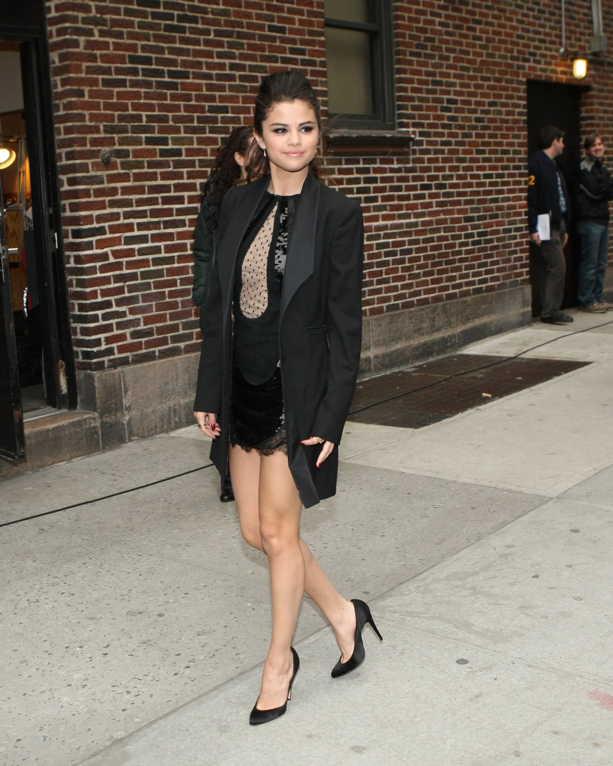Selena Gomez stopped by David Letterman's studios in NYC in a little black Emilio Pucci dress with polka dots, sequins, and lace. She completed her sexy look with a long tuxedo blazer by Dolce & Gabbana, black satin Brian Atwood pumps, and Melinda Maria jewels.