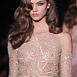 Karlie Kloss steps out for the Versace Autumn/Winter 2013 couture show with the perfect Veronica Lake waves. Don't try this at home, folks!