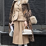 Style Your Leopard-Print Coat With: A Camel Suit and White Accessories