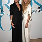 Twinning combo: The girls donned contrasting column gowns for the 25th CFDA Fashion Awards in June 2007.   Ashley borrowed her sister's edgy effervescence in a black tuxedo gown and slick updo.   Mary-Kate took a page from her sister's pristine playbook, working a darling white kimono-style wrap gown.