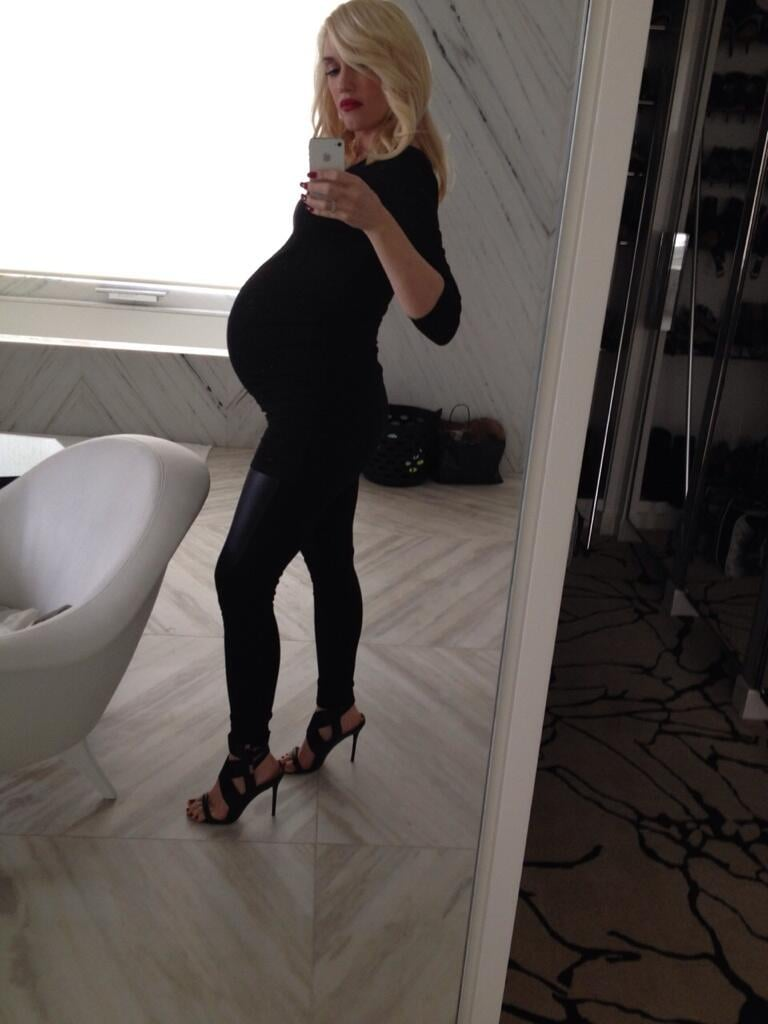 """Gwen Stefani shared a photo of her baby bump, saying, """"bump it #allblack #inappropriateshoes #capturethemoment #miracle."""" Source: Twitter user gwenstefani"""