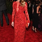 At the 2013 Met Gala, Amber Heard had another red-hot moment in a sparkly sheer Emilio Pucci gown.
