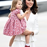Prince George and Princess Charlotte Stay Close to Their Parents as They Arrive in Poland