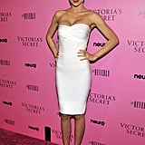 """At the 2011 Victoria's Secret """"What Is Sexy"""" party in LA, Miranda got back to basics in a white Hervé Léger bandage dress and strappy snakeskin sandals."""
