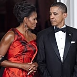 Barack noticed how red-hot Michelle looked in Alexander McQueen at the start of a state dinner for the Chinese president.