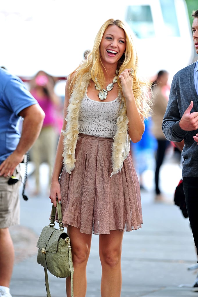 Blake Lively flashed a smile on set in September 2011.