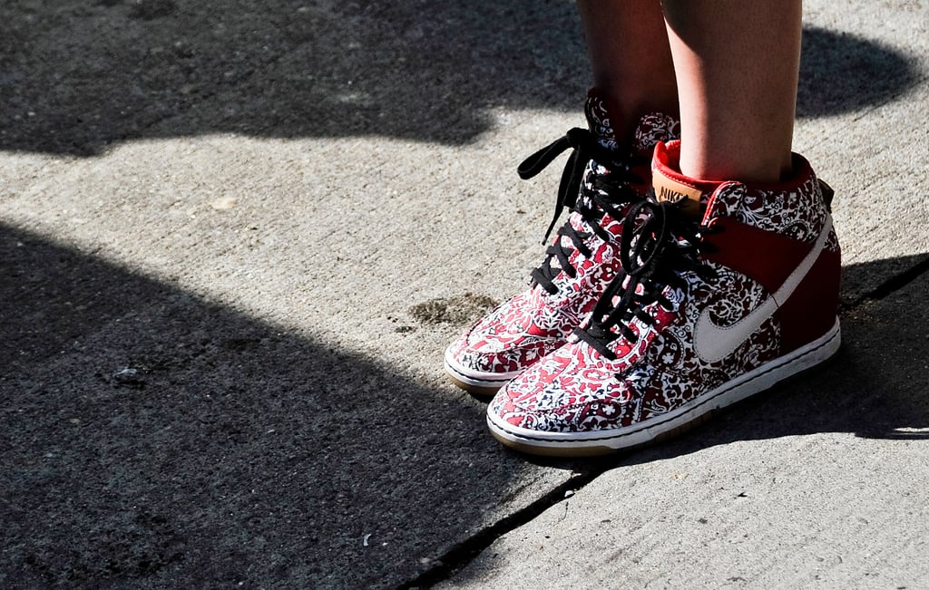Fashion meets function on a pair of Nike wedged sneakers with an eye-popping print.