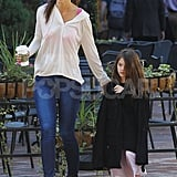 Katie Holmes put her hand on Suri Cruise's shoulder.