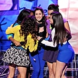 Contestants shared a group hug.