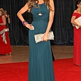 Sofía Vergara posed in a teal keyhole-cutout gown, which she finished with an armful of jewels and coordinating earrings.