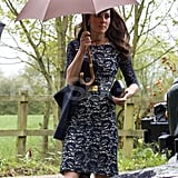 The Duchess of Cambridge, Kate Middleton, at Hannah Gillingham and Robert Carter's wedding with an Anya Hindmarch clutch.