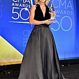 Behind the scenes, Carrie posed with her award and opted for a classic black halter gown without any embellishments.