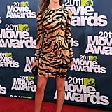 At the 2011 MTV Movie Awards, Rosie accessorised her animal-print Dolce & Gabbana dress with leather Sergio Rossi heels and a Salvatore Ferragamo bag.