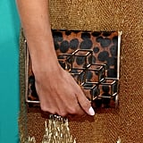 We love how Nikki Reed added interest to her gilded mini with a leopard-print clutch.