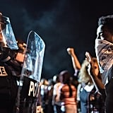 September 21: Police officers face off with protesters after the fatal shooting of Keith Lamont Scott in North Carolina.