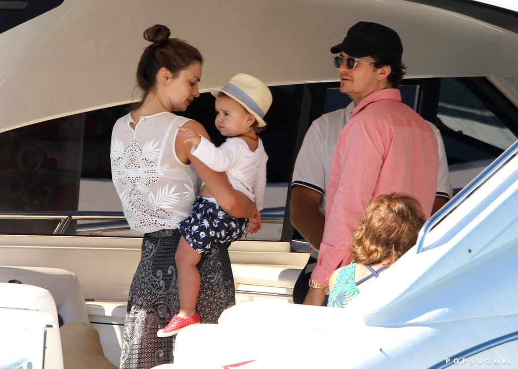 """Miranda Kerr and Orlando Bloom boarded a yacht as they left Hamilton Island in Australia yesterday. The family of three was on vacation in the exotic location and stayed at the luxurious Qualia Resort. Miranda shared pictures on Twitter and wrote of the spot, """"Most beautiful place on Earth."""" It may have been a belated celebratory getaway, since Miranda and Orlando's second wedding anniversary was in late July. The couple was back together after their busy schedules kept them apart for part of last month. Miranda took care of business and stepped out with Flynn in NYC, while Orlando traveled to London to attend an event. Miranda and Orlando were the subjects of divorce rumors recently, but Miranda's rep quickly denied that there is any trouble between the duo."""