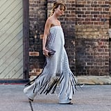 A Strapless Dress Over Wide-Leg Pants Is a Winning Combination With a Casual Touch