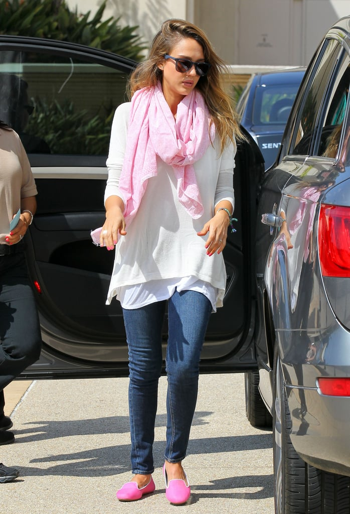 While shopping around Beverly Hills, Jessica topped her white blouse and skinny jeans with neon pink Charles Philip smoking slippers and a matching scarf.