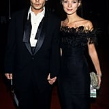 With Johnny Depp in 1995, wearing a feather-trim dress.