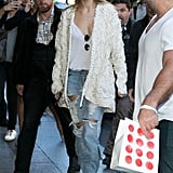 Gigi Kept the Look Casual, but Cool With a Pair of Ripped Denim and a Cream-Coloured Jacket