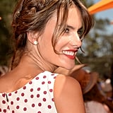 At the Los Angeles Veuve Clicquot Polo Classic, model Alessandra Ambrosio pulled her hair up into a playful milkmaid braid. She also matched her bright poppy lipstick to her crimson-colored polka dots.