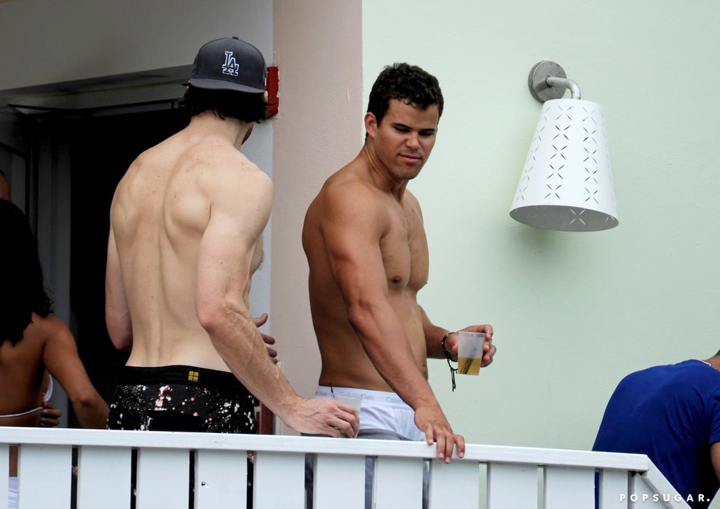 Basketball player Kris Humphries put his muscles on display during a party in Miami back in July 2012.