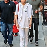 Selena's The Mighty Mighty Bosstones t-shirt made an appearance again, though this time she wore it with white joggers, white sneakers, and draped a sweatshirt over her shoulders.