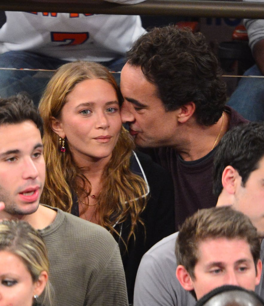 Mary-Kate Olsen got a kiss from her boyfriend, Olivier Sarkozy, at the New York Knicks game in November.
