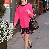 Emmy Rossum smartly used a hot-pink Style Stalker sweater to give her black-and-pink floral Milly dress a transitional twist. A black Gerard Darel satchel, two-toned Aldo flats, and cat-eye sunglasses served as her fabulous accessories for her daytime LA look.