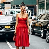 A smocked bodice and pleated skirt is the recipe for a totally romantic look, no matter how you style it.