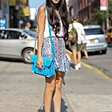 Sequins and a bold bag pack a stylish punch in this girlie getup.