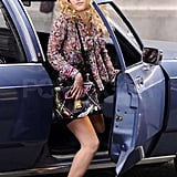 AnnaSophia Robb shows off her Carrie Bradshaw style while hopping out of a car in NYC.