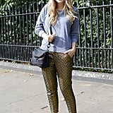 To pare down her look, she juxtaposed printed trousers against a low-key gray sweatshirt.