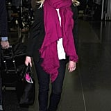 Reese Witherspoon wore a pink scarf as she arrived at JFK airport in NYC.
