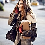 Mix and match your shearling and leather with more classic pieces, like plaid wool and camel. It takes your layers to another level, very chic.