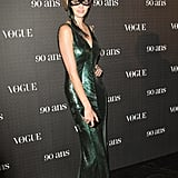 Can you tell who that is? It's Lara Stone, looking dazzling in green sequins at Vogue's 90th anniversary party in Paris.