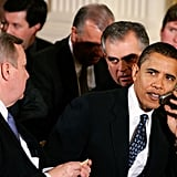 Chatting on his flip phone at the White Sox championship victory visit to the White House in 2006